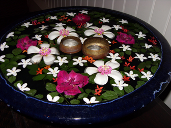 Thai orchids floating in a bowl